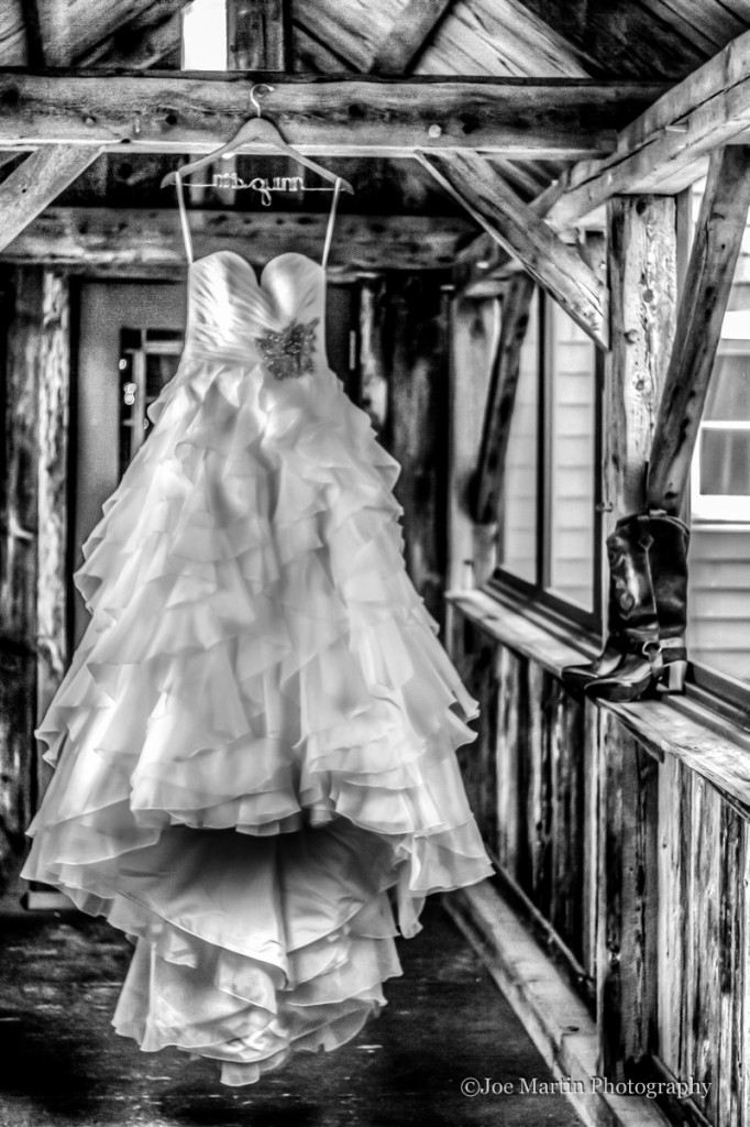 Image of a wedding dress hanging on the walk way at a wedding venue in New Hampshrie