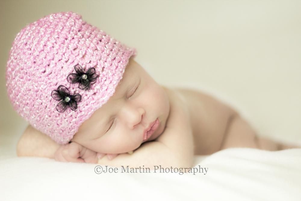 newborn baby photo in pink hat