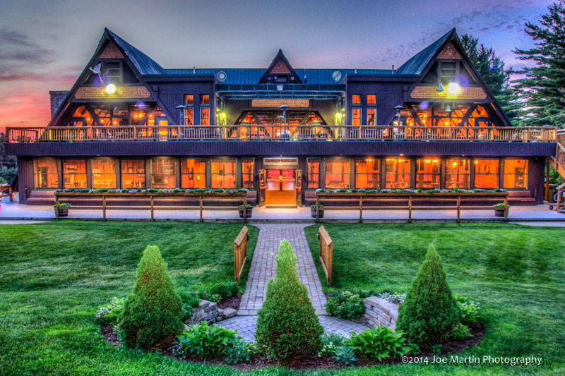 "Sunset photo of the ""Sleigh Room"" and banquet center at Pats Peck a NH wedding venue"