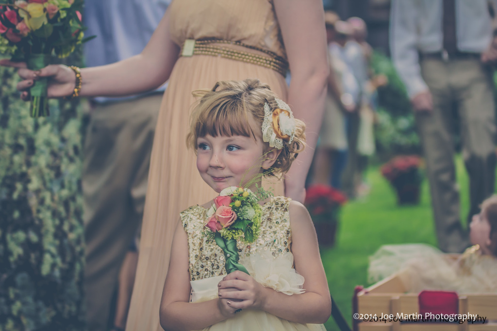 flower girl carries flowers in a wedding ceremony