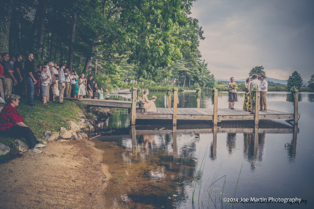 bride and groom getting married on a dock at the lake.
