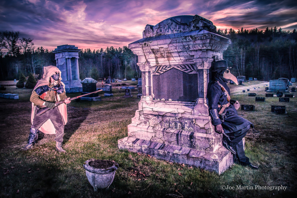 Coseplay style Image of two costumed young men in a cemetery with amazing clouds over them.