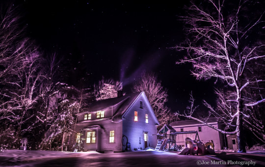 Night time photography of my home covered in snow.
