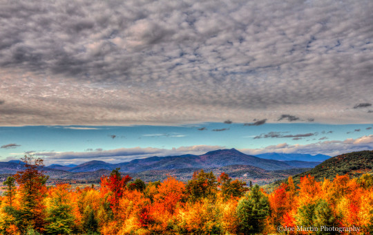 Landscape photograph view across a New England mountain range in the fall full of color