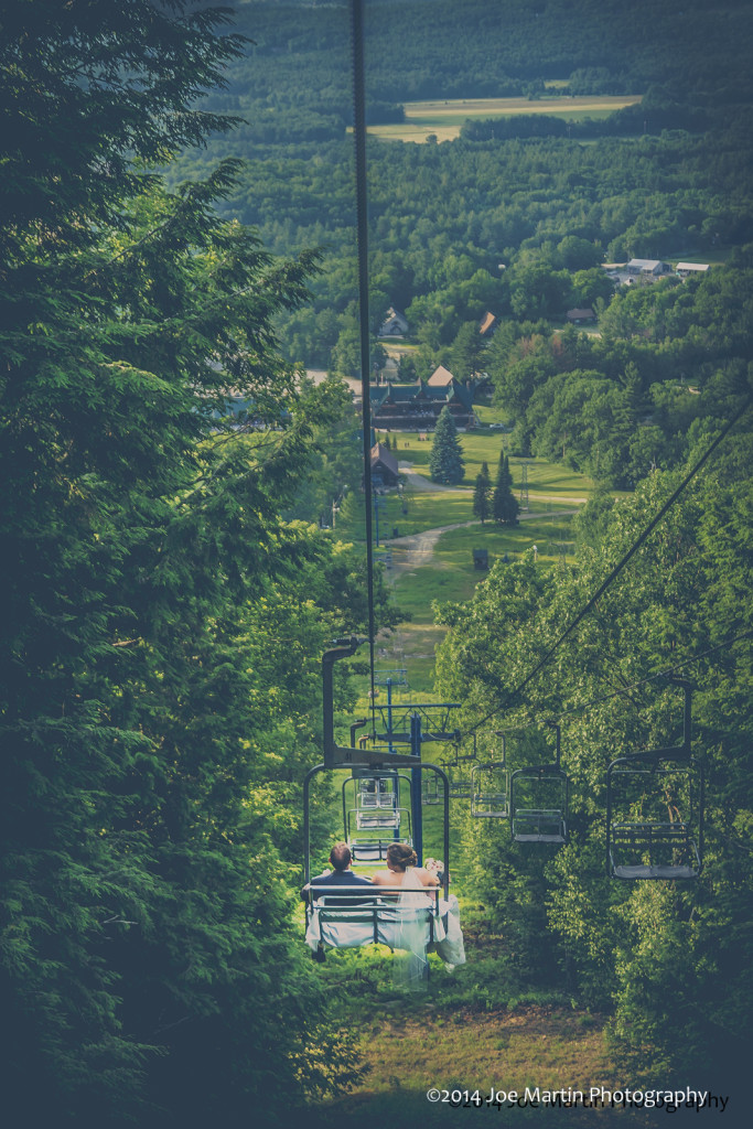 Bride and Groom riding down a chair lift after their mountain top wedding