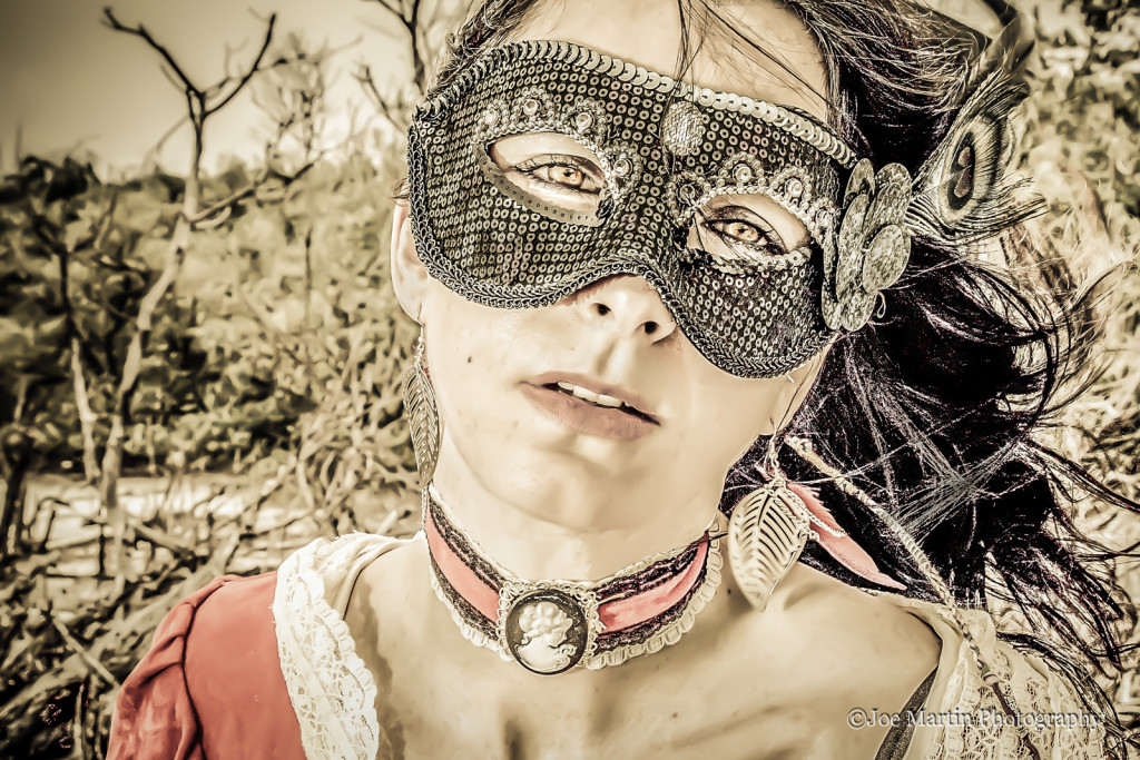 Exotic portrait of a beautiful woman with a Zorro mask on