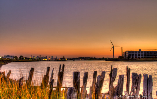 Sunset photo looking towards city of Boston MA looking over the Chelsea River