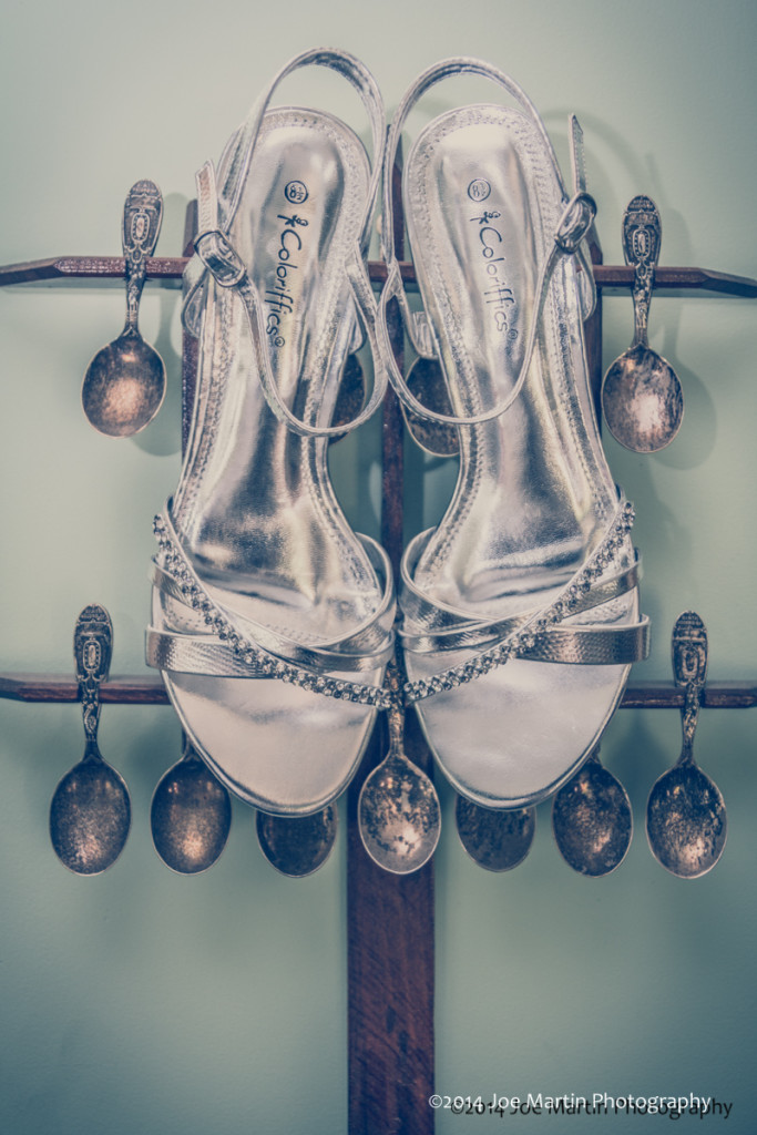 photo of wedding shoes and the brides families baby spoons display