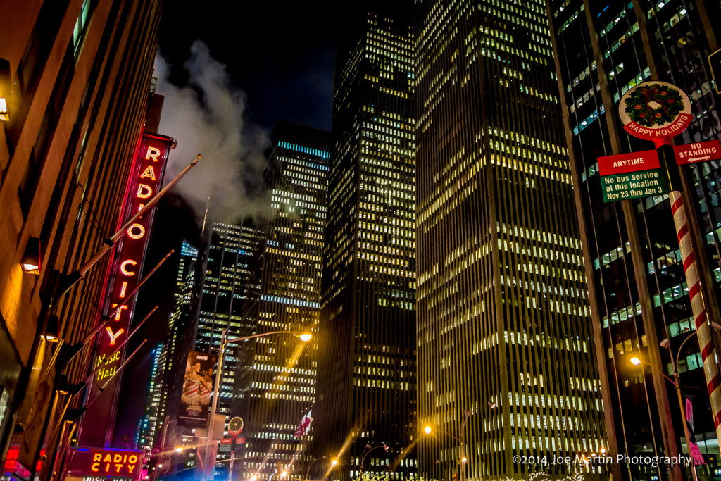 city scap photo from NYC many building and the Radio City MusicHall marquee