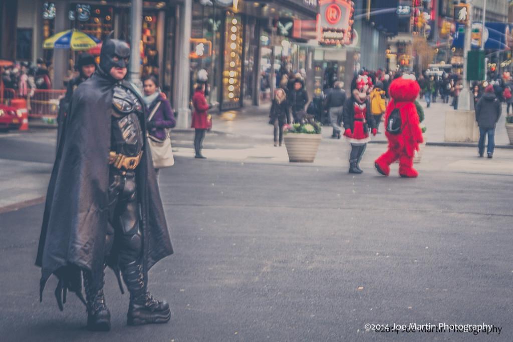 Street photo of street actors Batman is in view n NYC