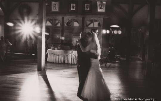 Black and white photo of the father of the bride and the bride dancing.