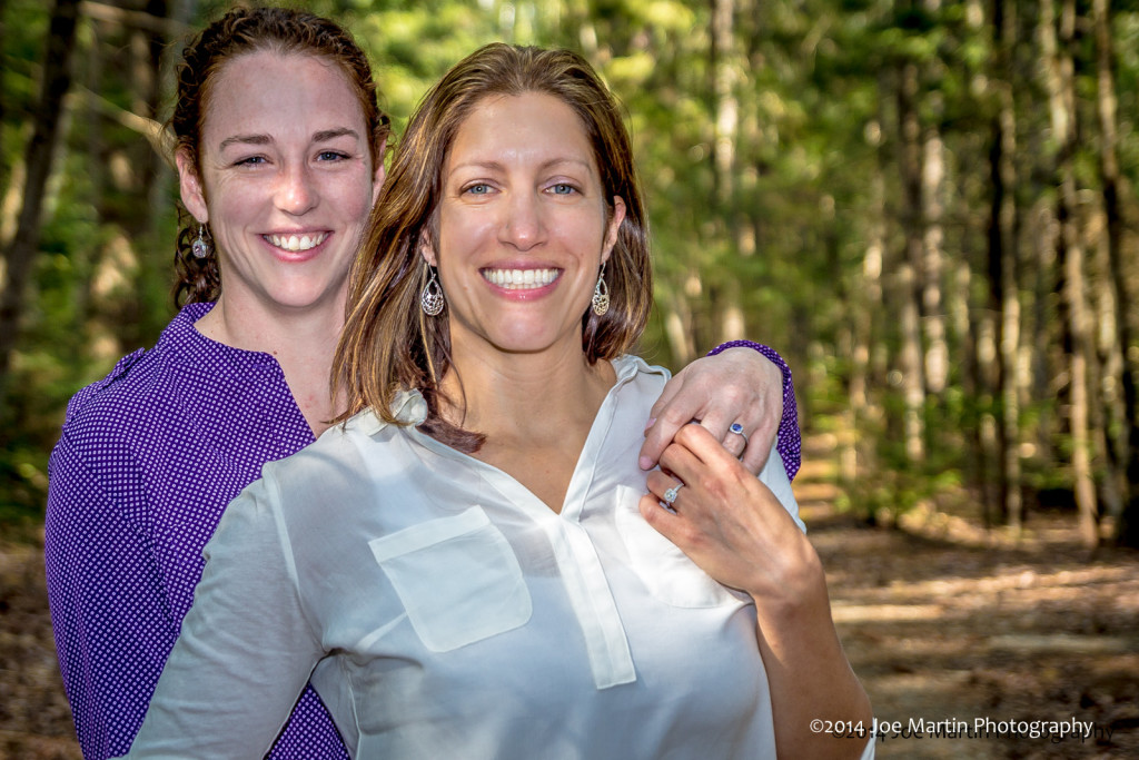 Lesbian  couple posing for an engagement photo
