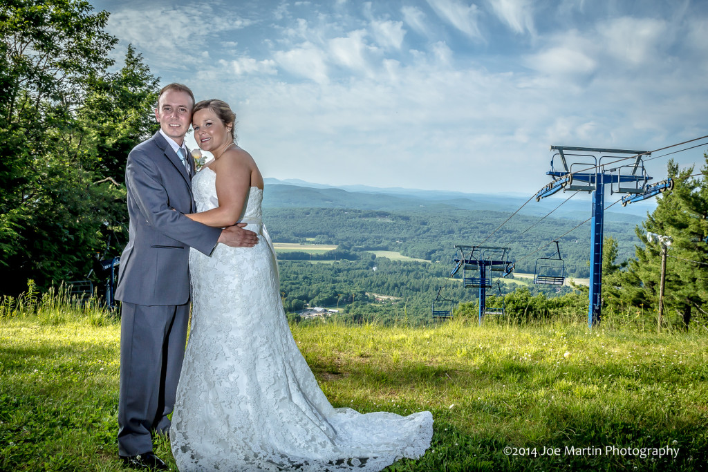 Mt Top wedding couple posing in front of a dramatic sky