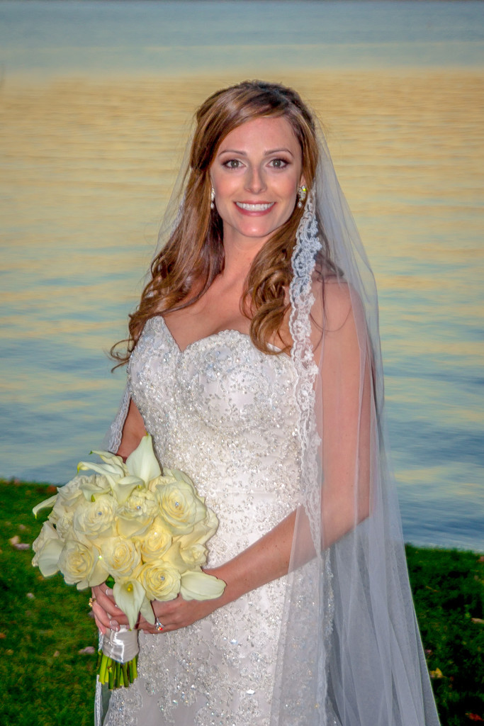 Bride at golden hour near the water.