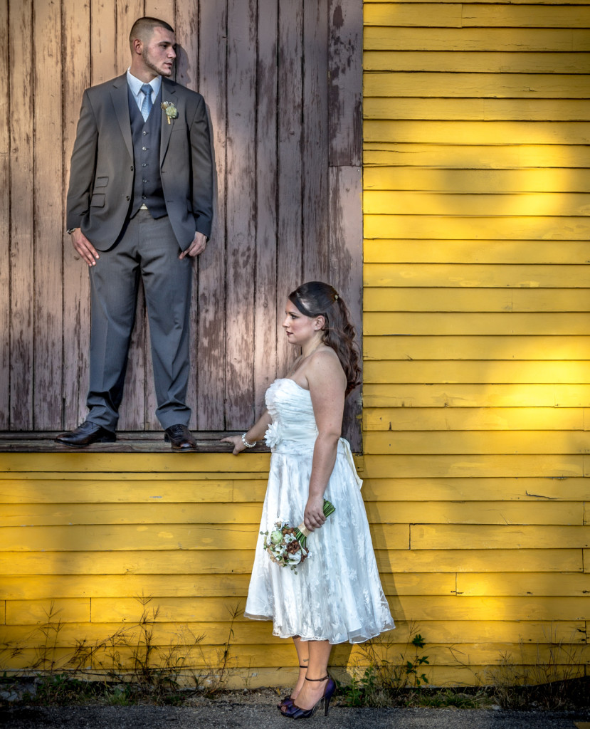Moody wedding photo of a couple posing together but seeming apart