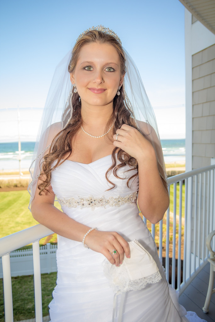 Pretty bride poses moments before her wedding.