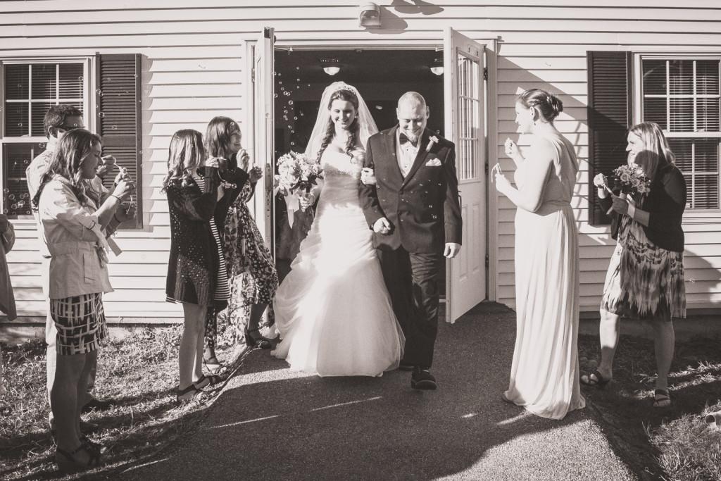 Wedding couple exits a church