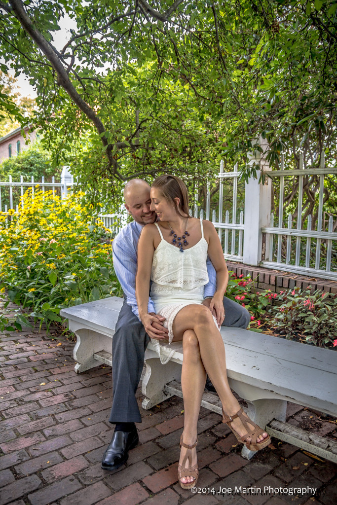 Couple posing on a park bench