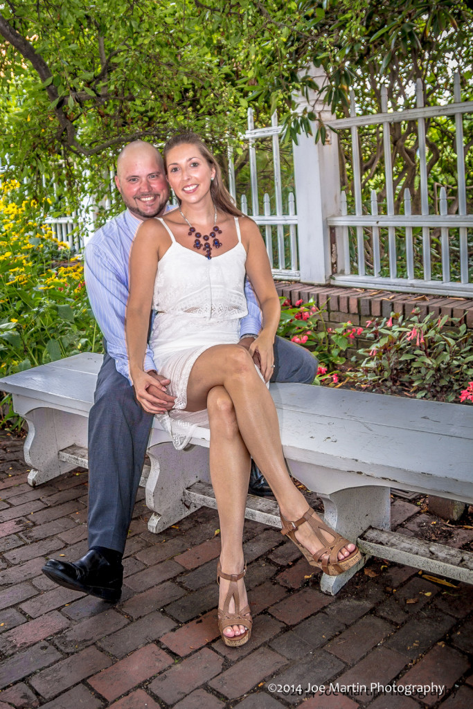 A second photo on the bench with a young wedding couple