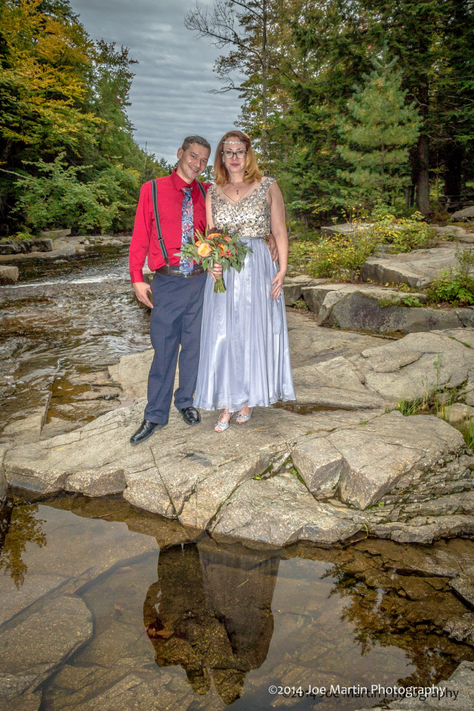 Couple poses near Jackson falls for some wedding photos New Hampshire Wedding Photographers