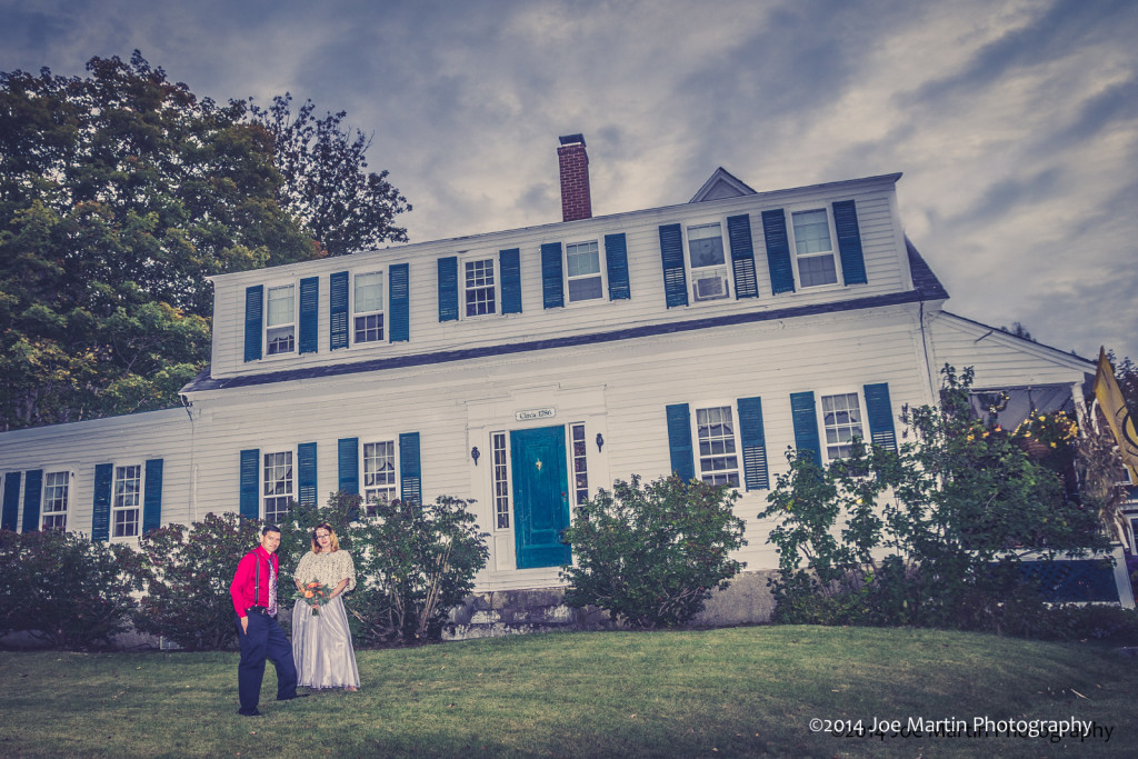 Posed wedding photo in front of the Christmas farm inn