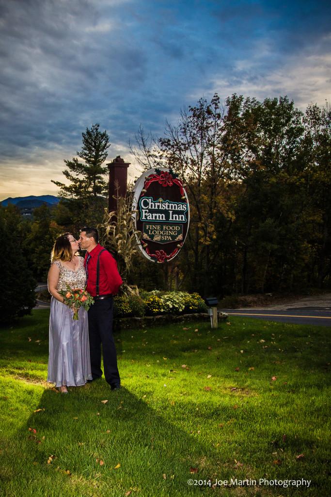 Couple posing near venue sign