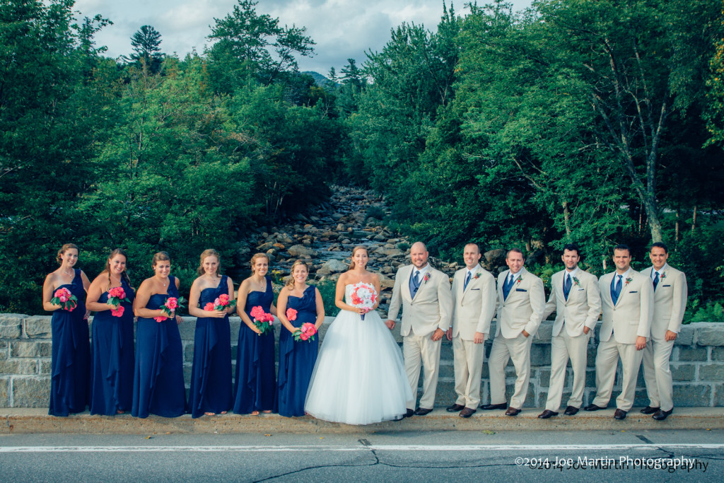 Bridal party poses near the river in Jackson NH