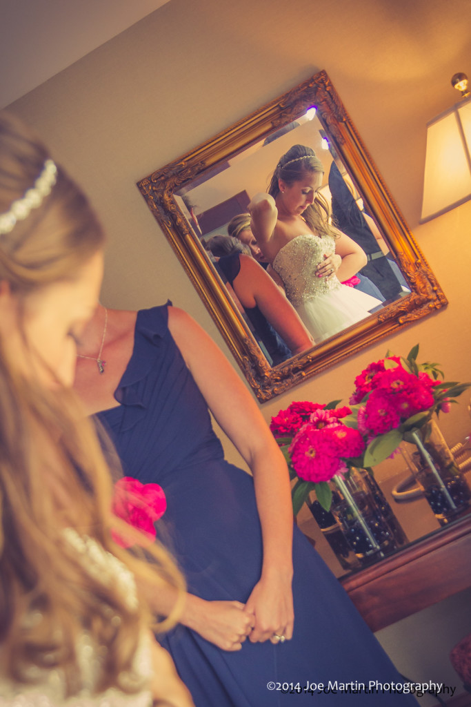 reflecting bride in the mirror