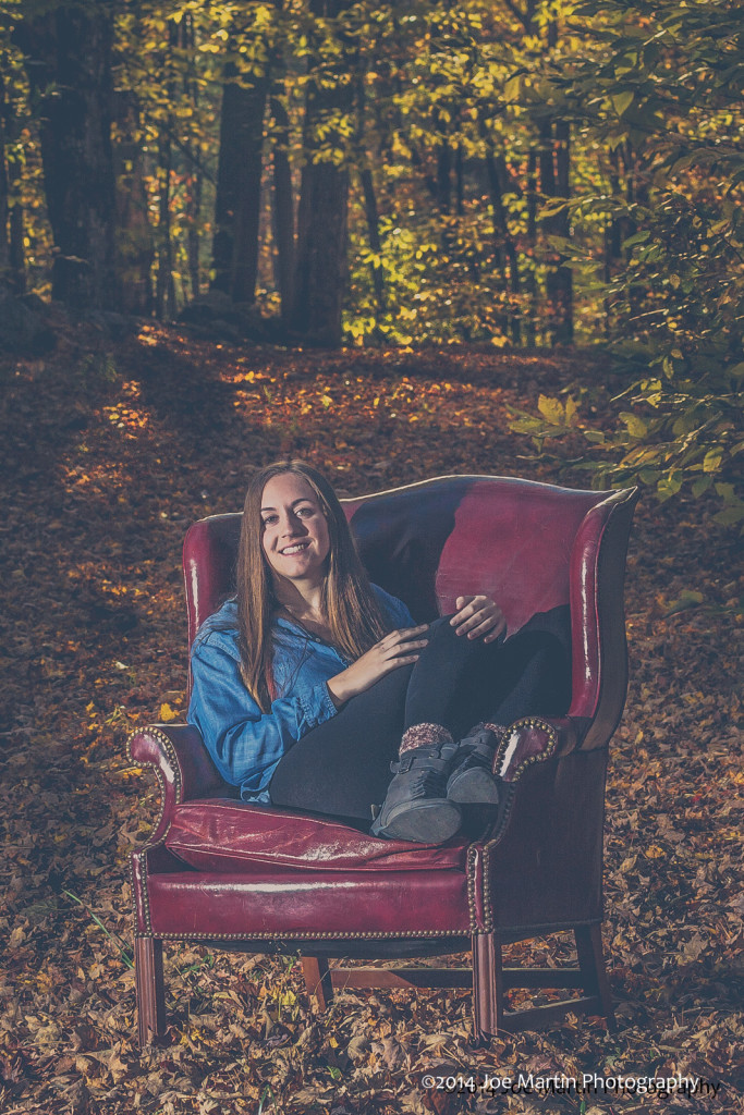 Red chair in the woods, Seems out of place at the same time creating a mood.
