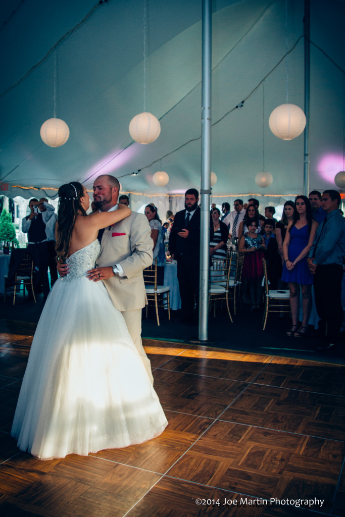 couple dancing close at their wedding.