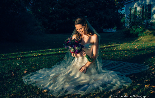 Bride poses for a portrait after her New Hampshire wedding