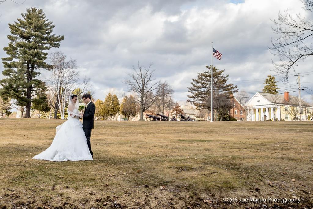 The sky and the scene create a dramatic wedding photo.