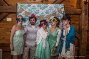 wedding guest in a photo booth