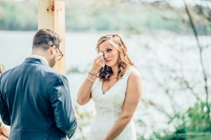 Bride wipes tears at her wedding