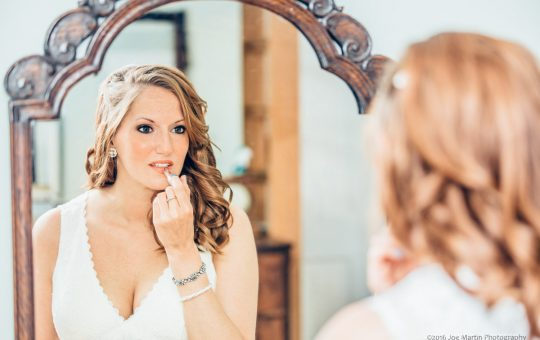 Bride doing her makeup before her wedding in Freeport Maine