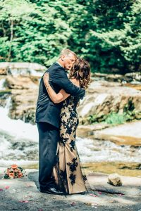 a kiss is shared at a river wedding in New Hampshire
