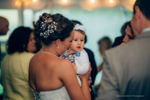 bride holds someones baby