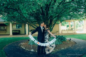 couple hold a Just married sign