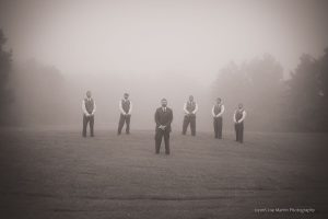 groomsmen waling in the fog