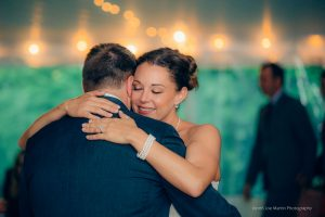 she hugs her groom during the first dance