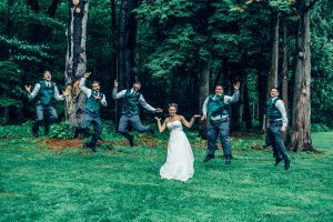 the groomsmen jump with the birde