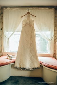 wedding dress haning in a window