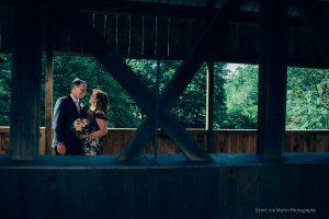 wedding photo taken at the Jackson Covered bridge in NH
