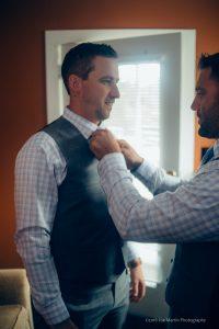 best man helps groom