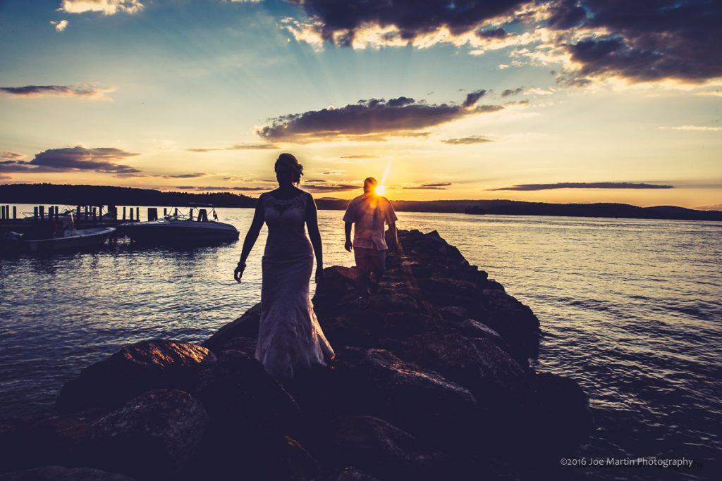 A couple after a brdial portrait on Lake Winnipesaukee in Laconia