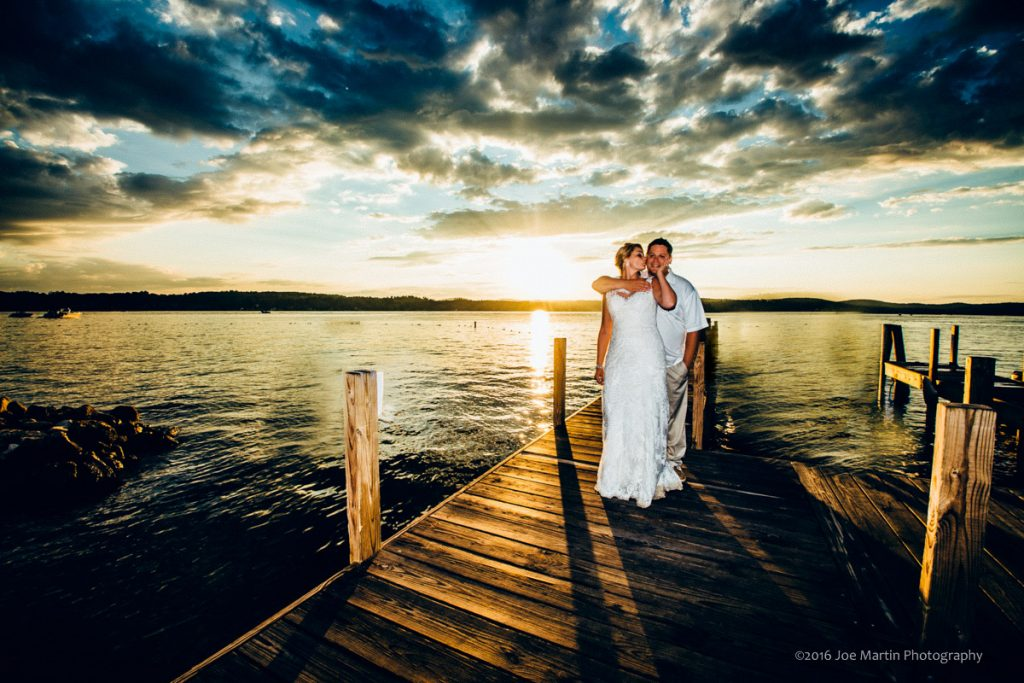 Wedding couple poses for a sunset photo