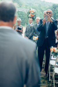 wedding guests take photos