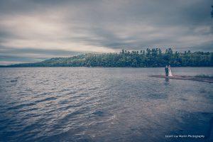 lake as a backdrop for a wedding photo