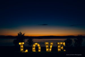 sunset wedding photo at The Margte resort in Laconia NH
