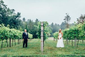 couple poses in the vineyard at the Zorvino Vineyards a New Hampshire wedding venue